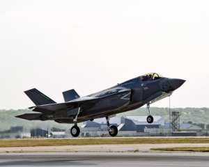 ZM135, a British F-35B and the first international Lockheed Martin Lightning II, takes off from Naval Air Station Fort Worth Joint Reserve Base on July 23, 2012, en route for Eglin Air Force Base, Fla. The U.K. officially took ownership of ZM135 (formerly known as 'BK-1') at a ceremony in Fort Worth on July 19, 2012. The jet will be used for operational testing and evaluation. Lockheed Martin photo