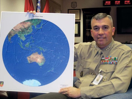 "Lt. Gen. John E. Wissler holds up a map titled, ""The Darwin View,"" graphically illustrating the sense of basing a force of Marines in the Australian port city. Photo courtesy of John D. Gresham"