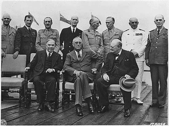 """Attendees at the Quadrant Conference in Quebec. President Franklin D. Roosevelt, Prime Minister Winston S. Churchill, Mackenzie King, and several military personnel in Quebec. From left to right: (Seated) Prime Minister of Canada William  Mackenzie King of Canada, President Franklin D. Roosevelt, British Prime Minister Winston S. Churchill. (Standing) Gen. Henry """"Hap"""" Arnold, Air Chief Marshal Charles Portal, Field Marshal Sir Alan Brooke, Adm. Ernest J. King, Field Marshal Sir John Dill, Gen. George C. Marshall, Adm. Sir Dudley Pound, and Adm. William Leahy. Library of Congress photo"""