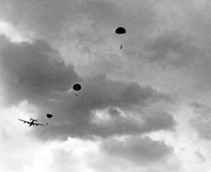 Jedburghs parachute from a B-24 Liberator. National Archives photo
