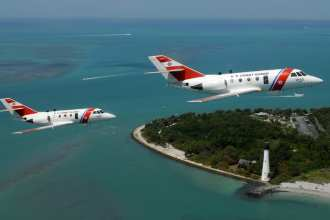 Pilots from Coast Guard Air Station Miami conduct an overflight with the HU-25 Falcon in  2008. The service has retired the last of its 41 HU-25 airframes. U.S. Coast Guard photo by Petty Officer 1st Class Jennifer Johnson