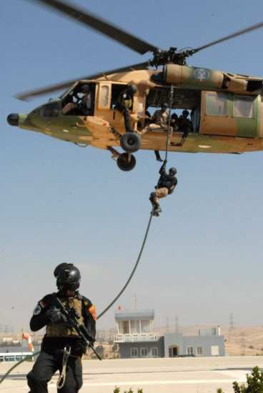 A member of the Jordanian SOF descends down a rope from a Jordanian UH-60 Black Hawk helicopter during Exercise Eager Lion at the Jordanian SOF compound near Zarqa, Jordan, June 13, 2013. Exercise Eager Lion 2013 is a U.S. Central Command-directed annual multinational exercise designed to strengthen to military-to-military relationships and enhance security and stability by responding to modern-day security scenarios. Jordan is one of the major FMF recipients. U.S. Army photo by Staff Sgt. Scott Griffin