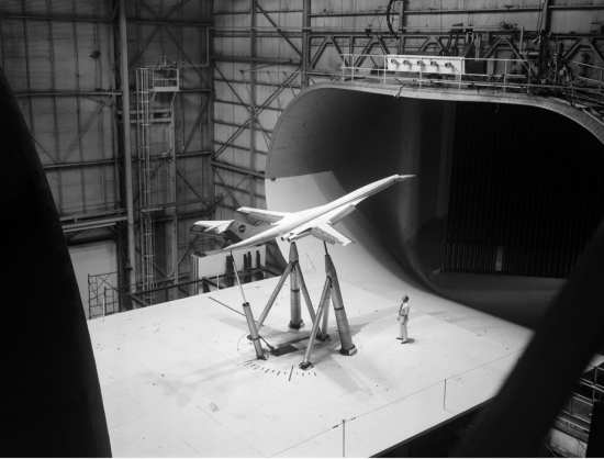 Model of the Super Sonic Transport ( SST) variable sweep version (with wings in the low speed position) mounted prior to tests in the Full Scale Wind Tunnel. NASA image