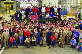 Anniston Army Depot and General Dynamics Land Systems first-shift employees gather around the 1,000th Stryker reset at the depot. The public-private partnership between the two organizations is a unique relationship that ensures an increased workload and the necessary employees to accomplish the mission and bring every Stryker to a mission-ready level for the Warfighters. Anniston Army Depot photographer