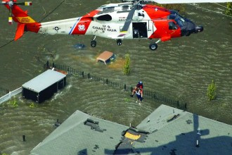 One of more than 33,000 people rescued by the U.S. Coast Guard in the aftermath of Hurricane Katrina, Aug. 30, 2005, in New Orleans. AP photo/David J. Phillip