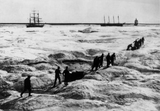 The men of the Overland Relief Expedition, one of the most famous rescues in Coast Guard history, approach a stranded whaling fleet on March 29, 1898. The men, serving aboard the Revenue Cutter Bear, were officers who volunteered to lead the expedition, which left on Dec. 16, 1897. U.S. Coast Guard Historian's Office Archives photo