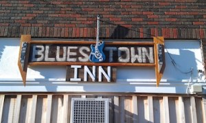 Blues Town Inn sign on front of building - still incomplete - surprise to come - in Clarksdale. Photo and signage by Delta Debris.