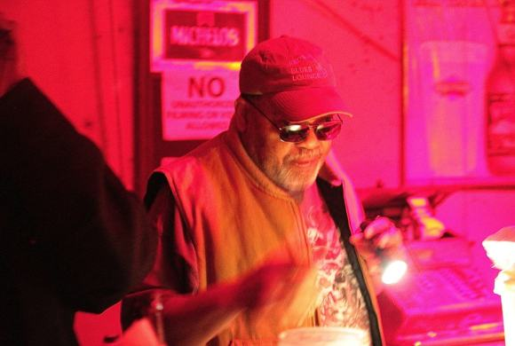 Red Paden using his flashlight at his Blues Club in Clarksdale. Photo by DELTA BOHEMIAN