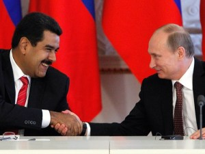 Russian President Vladimir Putin shakes hands with his Venezuelan counterpart Nicolas Maduro during a signing ceremony at the Kremlin in Moscow