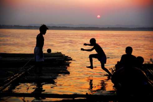 bathing at sunset Burma