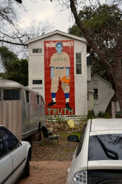 Huge mural on house in a neighborhood