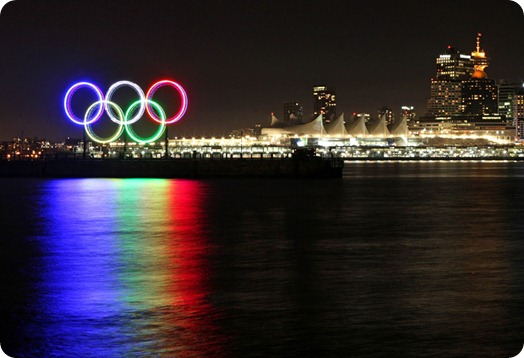 A tall set of Olympic rings were illuminated in the harbor outside the Vancouver Convention Centre, left, in Vancouver, B.C., on Wednesday Nov. 4, 2009. (AP Photo/The Canadian Press,Darryl Dyck)