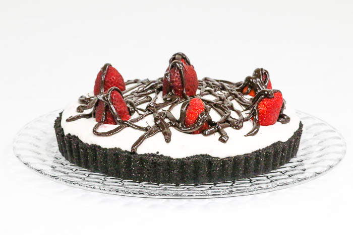 Chocolate Strawberry Tart is a delicious way to indulge in your favorite berry. Easy chocolate ganache layer, too.