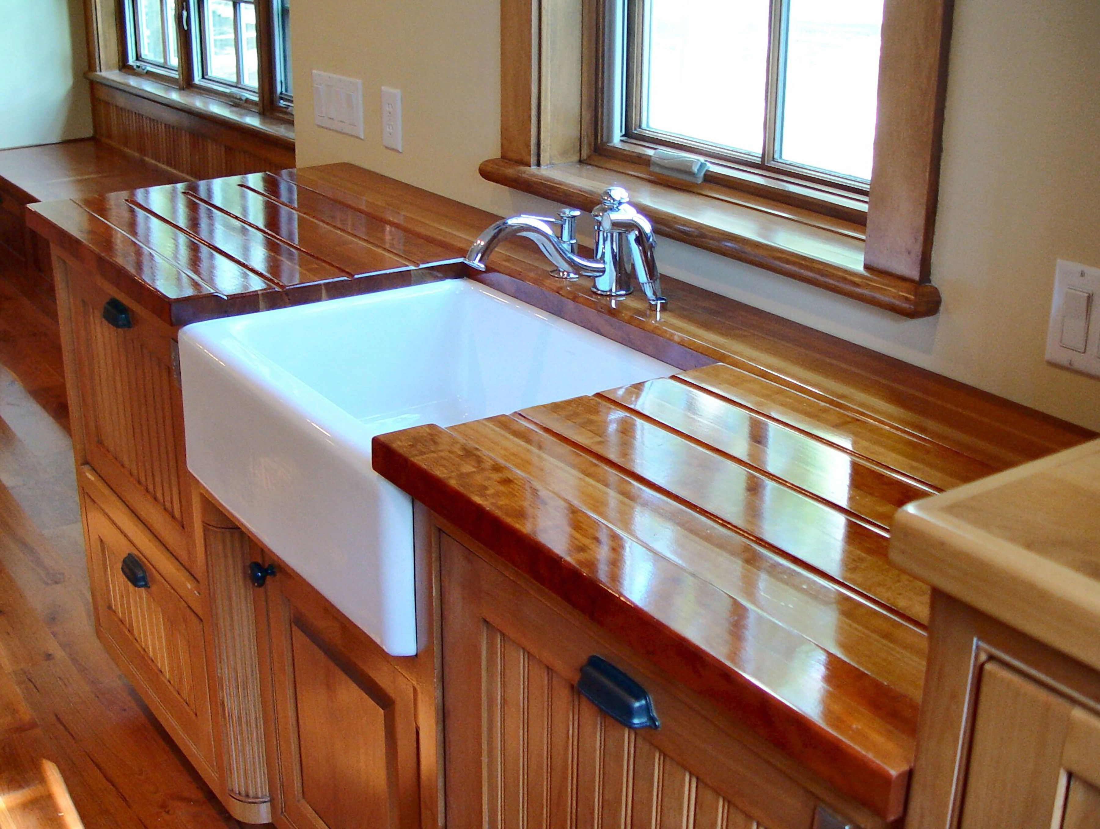 cutouts wood countertops kitchen Edge Grain Cherry Countertop with farm sink and Waterlox finish