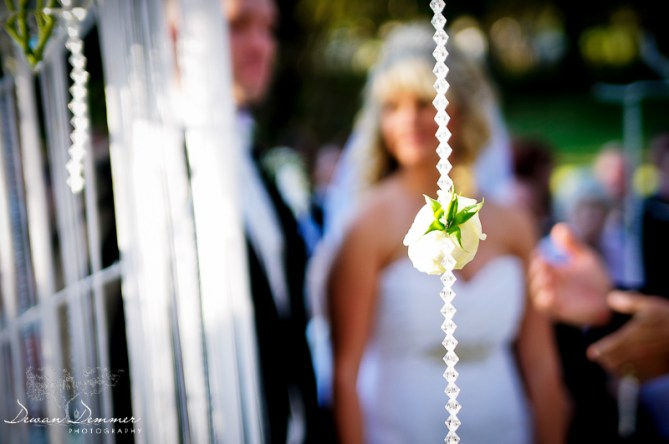 London Wedding Photography | elaborate outdoor ceremony a flower