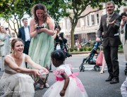 Bride collects coins tradition in front of the Stoke Newington Town Hall | London Wedding Photography