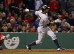 BOSTON, MA - MAY 1: Alex Rodriguez #13 hits 660th career home run to tie Willie Mays record during a game with Boston Red Sox in the 8th inning at Fenway Park May 1, 2015 in Boston, Massachusetts.   Jim Rogash/Getty Images/AFP