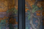 An al fresco painting sits behind a column in the Stockholm City Hall.