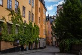 A small residential area of Stockholm's old town winds around to the community square, which also houses the Nobel Museum. July 2015.