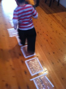 indoor bubble wrap hopscotch for bored toddlers