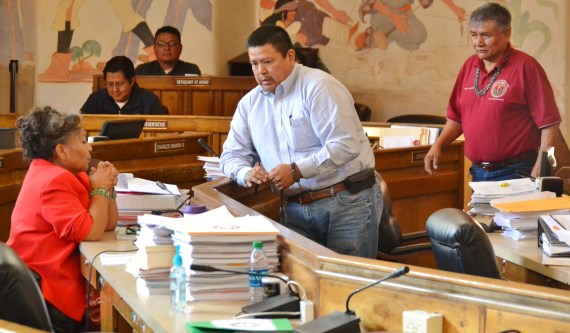 (L-R) Delegates Katherine Benally and Alton Shepherd chat as they wait for Naabik'iyati Committee to get a quorum and start. Delegate George Apachito also waits in the Navajo Council chamber on Feb. 13, 2014. Photo by Marley Shebala