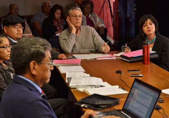 (L-R) Hydro-Uranium Resources Inc. of Texas reports to Navajo Council's Law and Order Committee about its proposed agreement with Navajo Nation for In-Situ uranium mining near Church Rock, N.M., in Window Rock, Ariz., on April 14, 2014. Committee member Russell Begaye is at forefront of photo. Anti-HRI community members Leona Morgan and Jonathan Perry sit at the table with HRI Vice President Mark Pelizza and HRI assistant Della Duran. Photo by Marley Shebala.