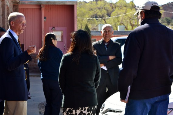 (Far left) Navajo Nation Department of Justice attorney Henry Howe talks with his clients during recess in Navajo Labor Commission hearing for complaint filed by five former tribal employees against tribal Controller Mark Grant for illegally laying them off. Grant is on the right and facing camera. Labor hearing at Window Rock, Ariz., on May 13, 2014. Photo by Marley Shebala.
