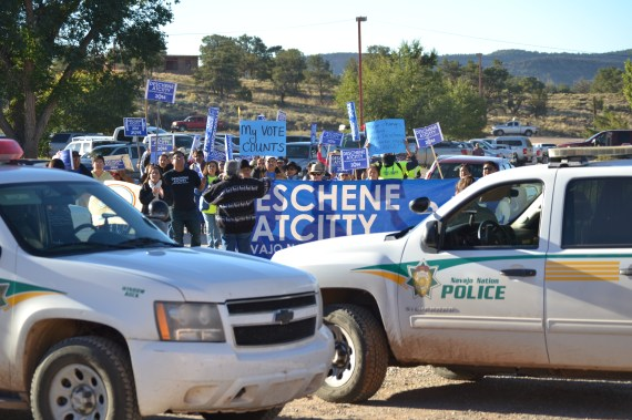 Supporters for Navajo Nation presidential candidate Chris Deschene marched from the intersection in Window Rock, Ariz., to the tribal Office of Hearings and Appeals to support Deschene, who is scheduled for a hearing on whether he is qualified to be a presidential candidate. Photo by Marley Shebala. Please give proper credit when re-using.