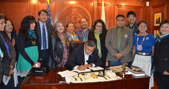 Diné Community Advocacy Alliance members and Navajo Council Delegates Danny Simpson and Jonathan Nez witnessed Navajo Nation President Ben Shelly sign the Healthy DinéNation Act of 2014 into law on Nov. 21, 2014, in the Navajo Nation Office of the President and Vice President in Window Rock, Ariz. (Courtesy photo from Navajo Nation Council public information office)