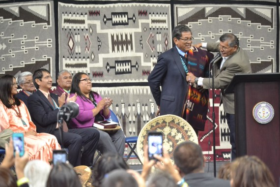Navajo President Ben Shelly presents President-elect Russell Begaye with a men's Pendleton blanket during the inauguration ceremony at the Fighting Scouts Event Center in Fort Defiance, Ariz., on May 12, 2015. Photo by Marley  Shebala