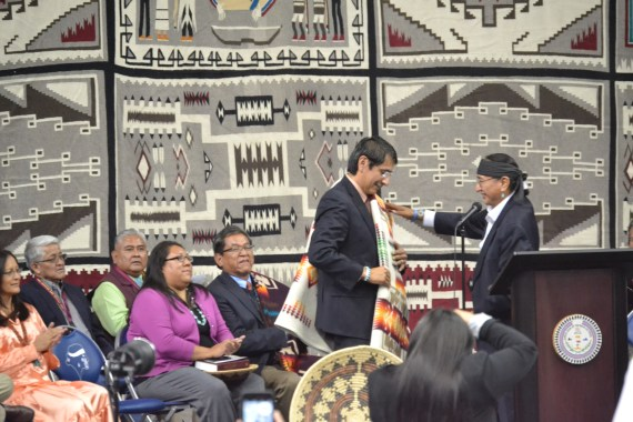 Navajo Vice President Rex Lee Jim honors Vice President election Jonathan Nez with a men's Pendleton blanket during the inauguration at the Fighting Sports Events Center in Fort Defiance, Ariz., on May 12, 2015. Photo by Marley Shebala