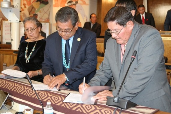 Acting Navajo Nation Chief Justice Eleanor Shirley, President Russell Begaye and Speaker LoRenzo Bates sign agreement during Council summer session at the Council chambers in Window Rock, Ariz., on July 20, 2015. Courtesy photo