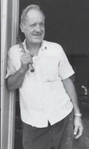 Father Diersen with hammer
