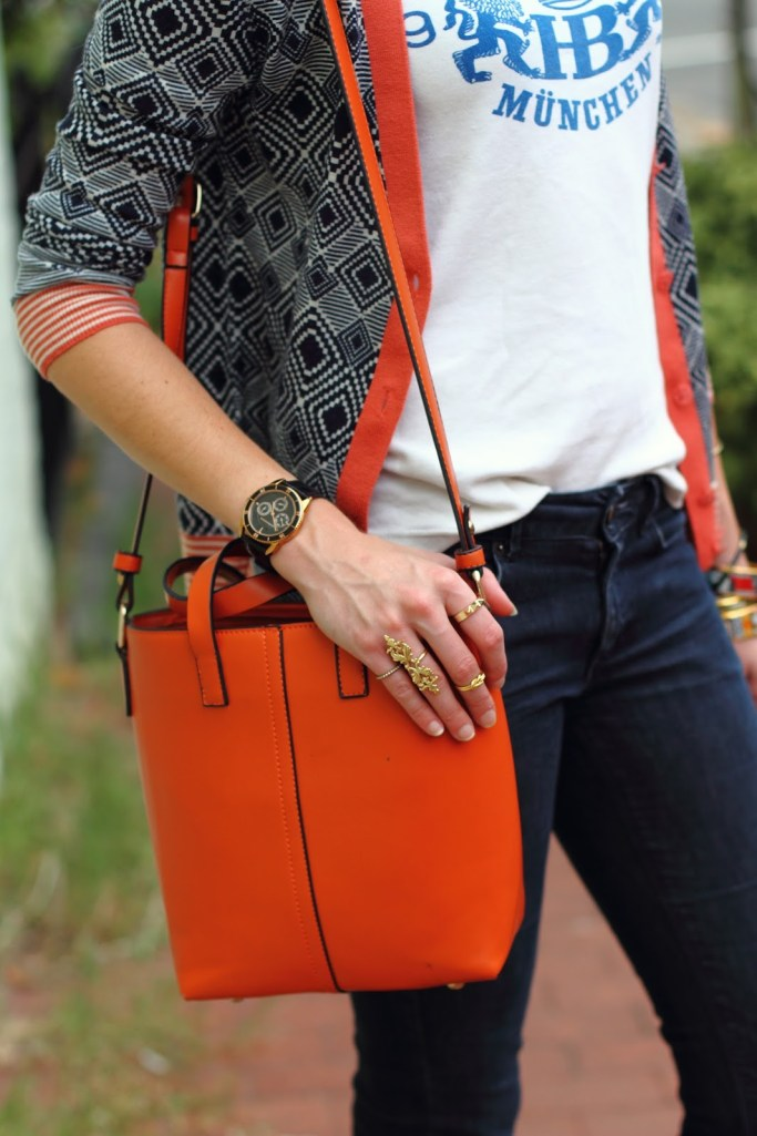gold rings and orange tote