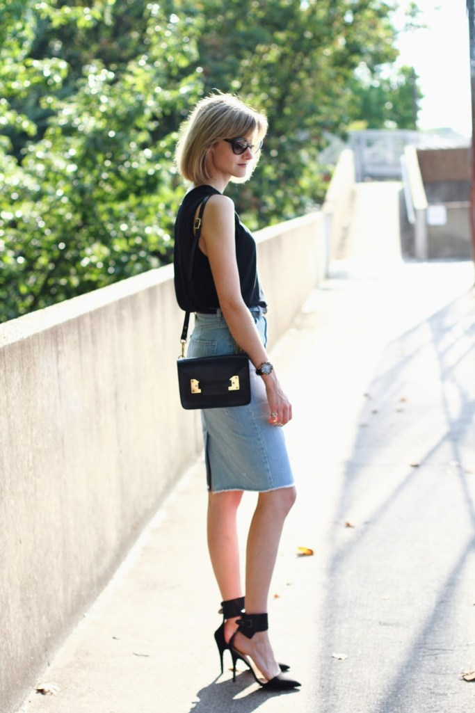 District of Chic: black top, denim skirt and ankle strap heels