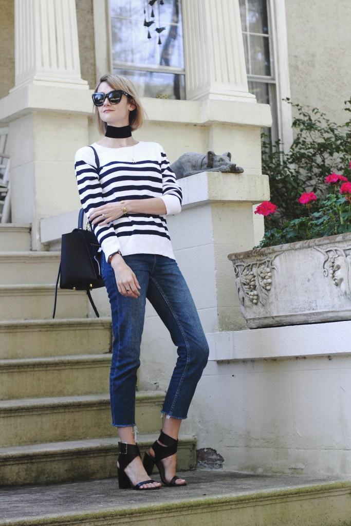 wide choker, striped sweater and raw edge denim