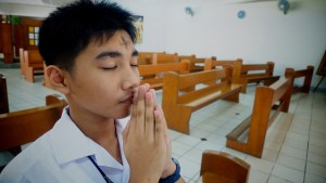 A student at Ateneo de Davao University High School prays on Ash Wednesday, Feb. 13, 2013. Photo by  Bro. Jeffrey Pioquinto, SJ/CC-flickr