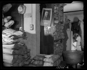 Interior of a Chinese laundry located under the apartment of Mrs. Ella Watson, a government charwoman, Washington, D.C., 1942. Photo by Gordon Parks, courtesy of Library of Congress