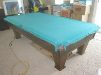 old felt in great shape, because the pool table was always covered