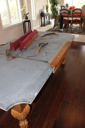 Removing the old Camel cloth on one of the rails.