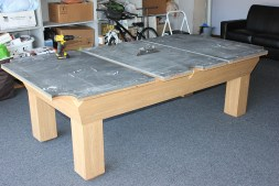 Here we have a three piece slate pool table being leveled up a garage.