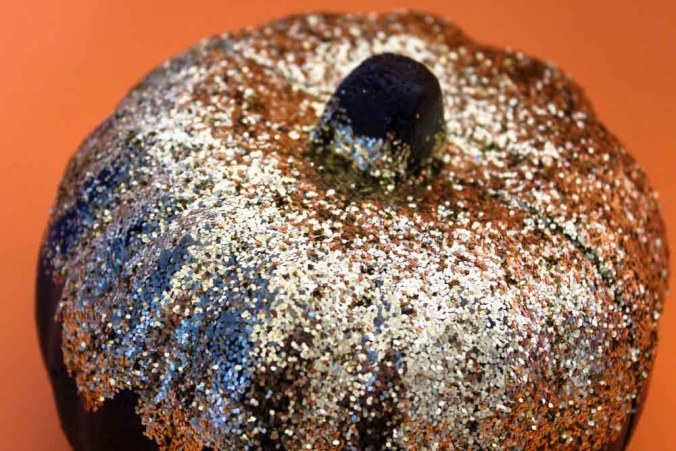 Transform foam pumpkins from the dollar tree into chic DIY Glitter Pumpkins for you halloween and fall decor!
