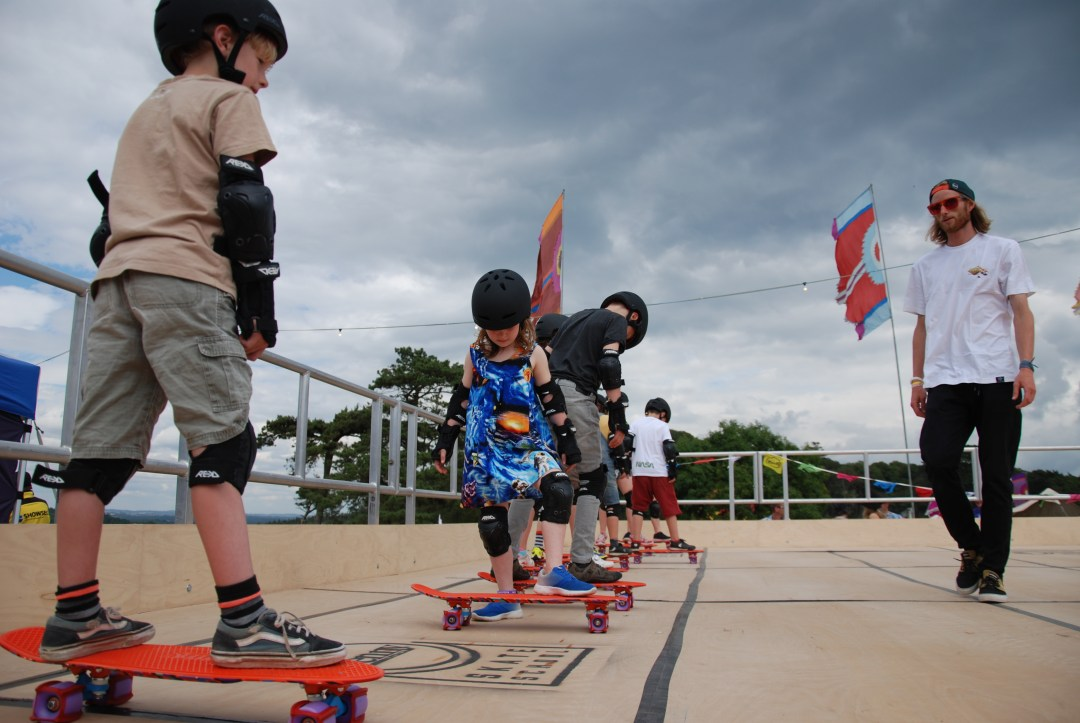 Don't Rain teaching with Penny Skate School at Camp Bestival Dorset UK