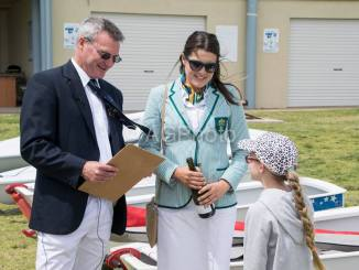 Adelaide Sailing Club commodore Darren McPherson and Olympian Ashley Stoddart christen an optimist on opening day. Photo: Ally Graham