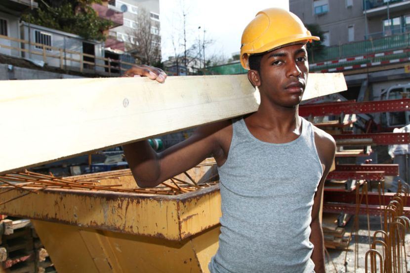 45127938 - young black man working in construction site