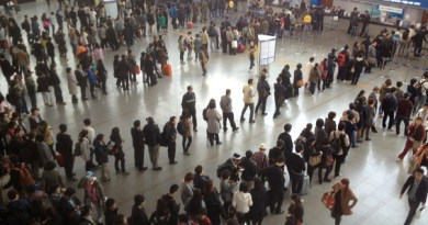 People queuing for train tickets at Seoul Station on a Sunday afternoon.