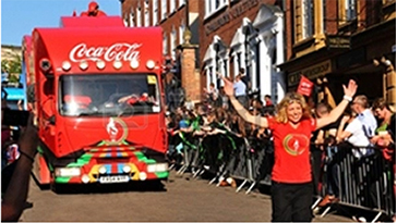 14339857-nottingham-uk-28-june-2012-london-2012-olympic-torch-relay-coca-cola-official-sponsors-convoy-salut