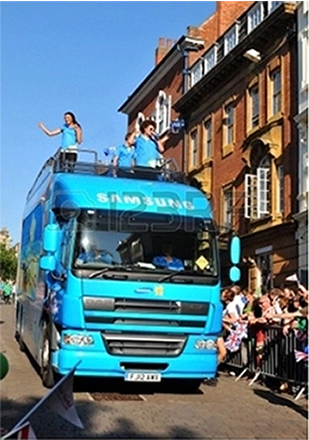 14339859-nottingham-uk-28-june-2012-london-2012-olympic-torch-relay-samsung-official-sponsors-convoy-salute-