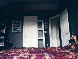 Our bedroom, with a homemade ladder to my little reading nook =]