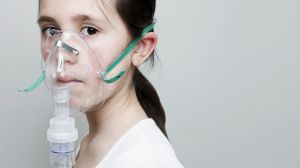GTY_girl_wearing_oxygen_mask_jt_140907_16x9_992